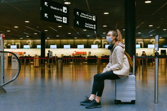 woman-sitting-on-luggage-3943882